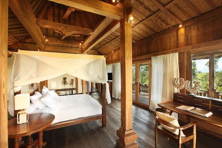 The main bedroom facing rice fields and sea at the distance