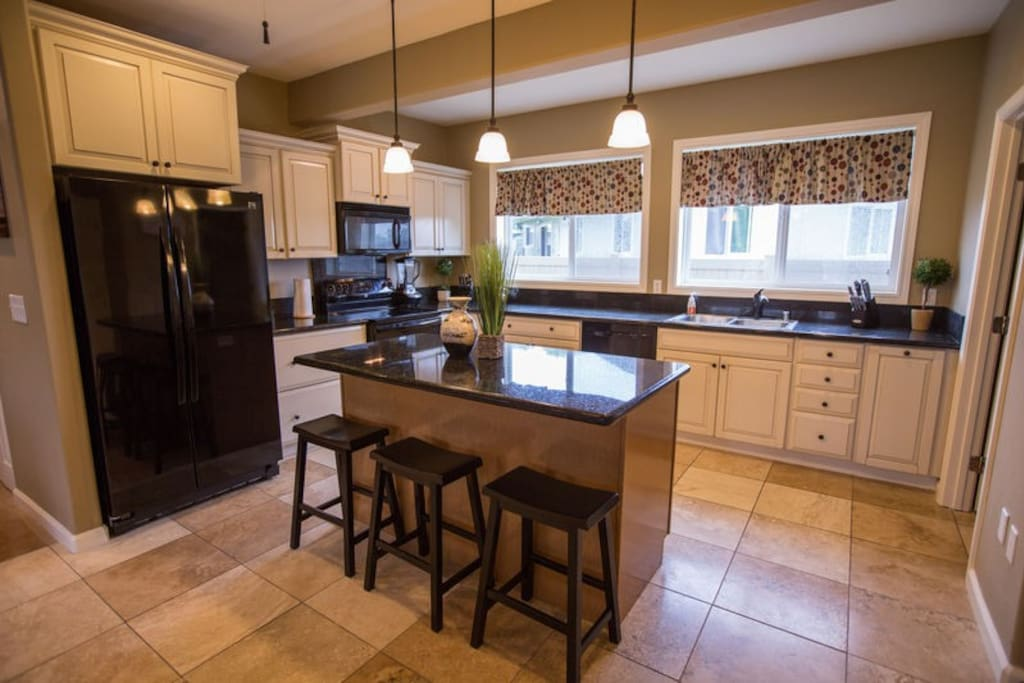 Our home features 2 full kitchens-perfect for larger groups! This kitchen is located downstairs and has 2 refrigerators.