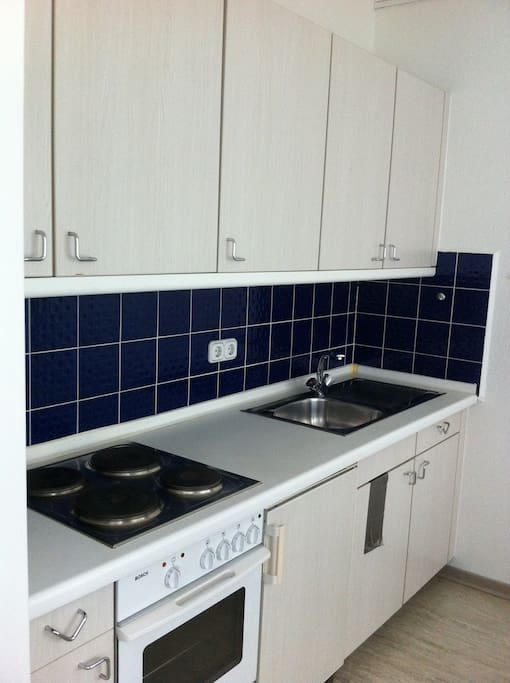 furnished and fully equipped kitchen with heating