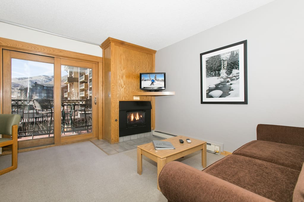 Living area with 32-inch TV and gas fireplace