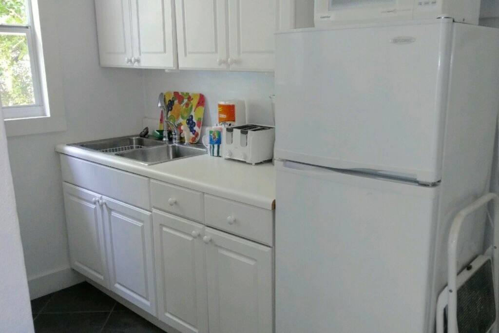 Windowed Kitchen with Large Toaster Oven, Microwave and Coffee Maker