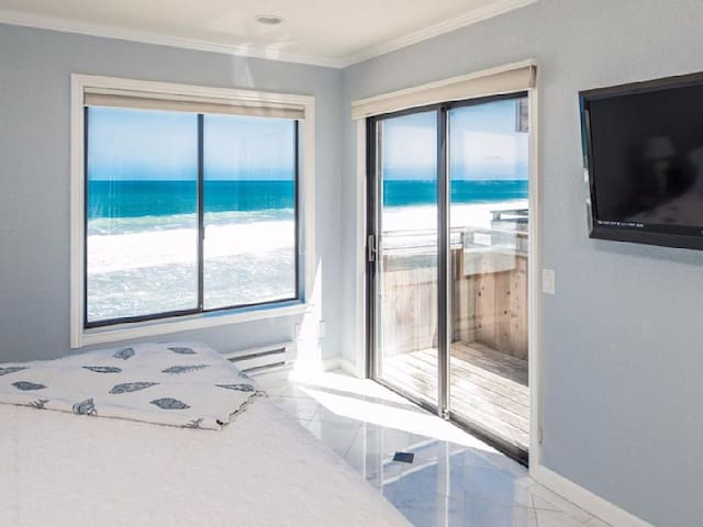 Bedroom has a spectacular ocean view and sliding glass doors out to the deck.