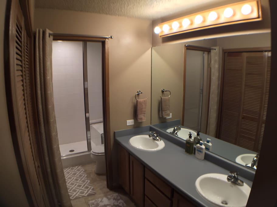 Spacious bathroom with steam shower and plenty of storage