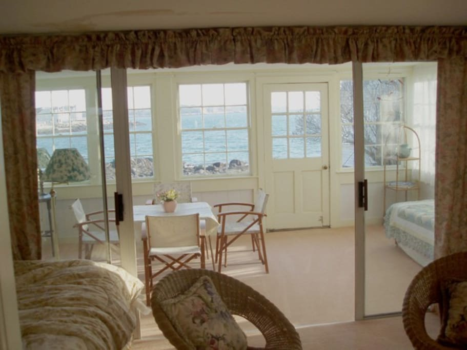 Large enclosed porch with water view