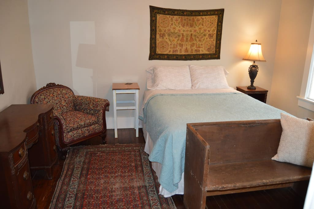 Relax and don't mind being lazy in this plush queen size bed accented by hand made tapestry I brought back from Afghanistan. Use the old yellow poplar church bench to place your luggage on, or have a seat to take your shoes off and stay a while.