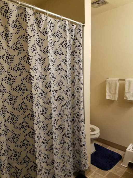 A shared bathroom with personal towels