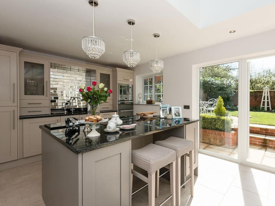 The stylish kitchen with patio doors leading to the garden