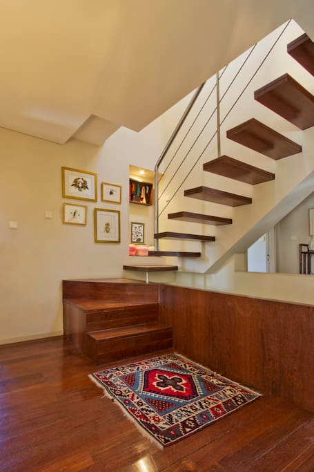Stairwell in hallway leading to loft