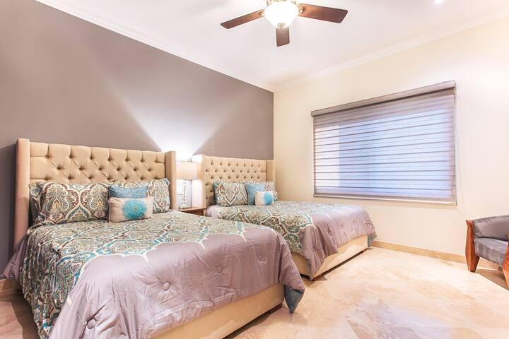 Bedroom 2 - Queen and Double Beds