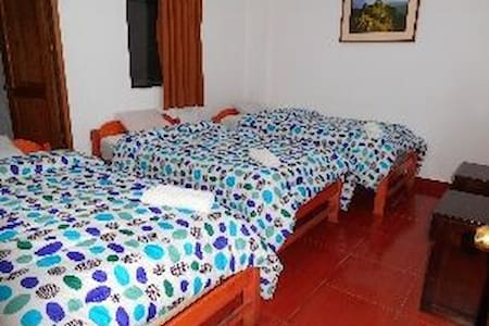 triple/sol naciente hostal/Machu Picchu