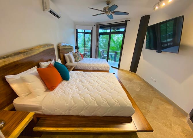 Floating Hardwood beds with a 65 inch TV with digital English cable and 1000 movies on it's harddrive.  This bedroom has twin Queen size beds, the other is similar but with a single King.  Both bedrooms have twin rain showers and unlimited hot water.