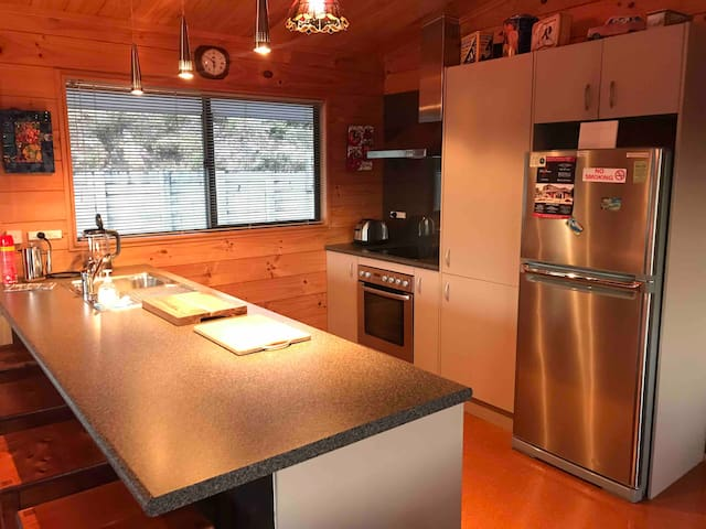 Kitchen includes Full sized oven & ceramic cook top, Large fridge/freezer, dishwasher, toaster, electric jug, kitchen essentials, cooking oil, salt & pepper, tea, coffee, sugar, (milk if desired, please let your host know)