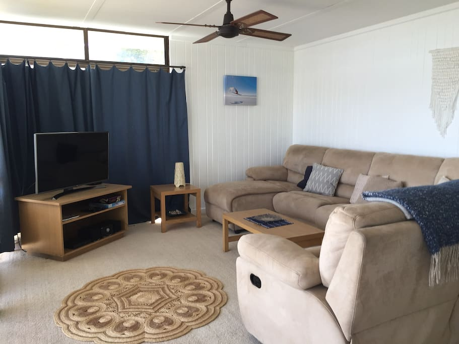 Massive lounge with recliner  & smart TV