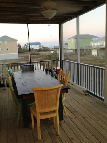 Screened Dining Porch with views of the Mobile Bay and Gulf of Mexico