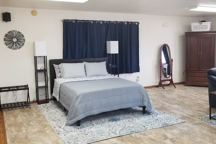 Queen sized bed (bed #1), armoire, luggage rack & full length mirror. Nightstands each have built-in light, 2 USB charging ports & 1 electric outlet.  Two folding privacy screens available upon request