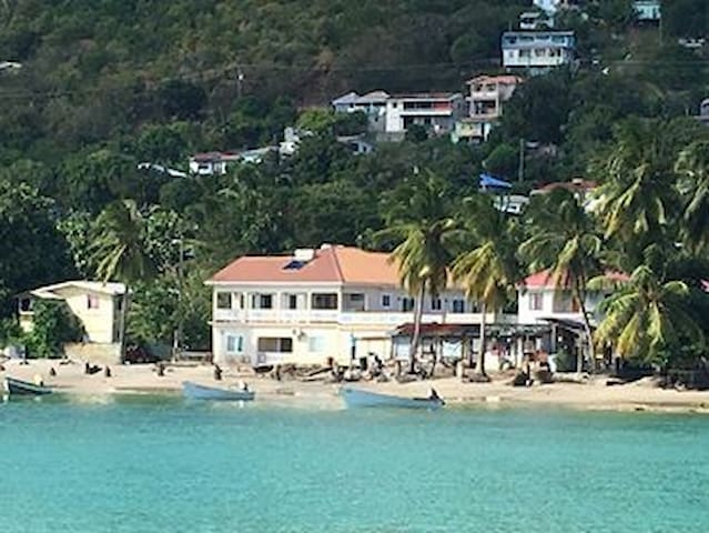 The view of the house from the sea--we are right on the beach!