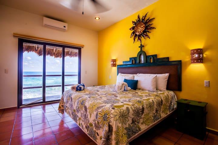 Master bedroom with ocean front balcony, full en-suite bathroom and closet.