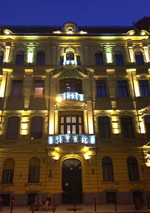 The building, at night.