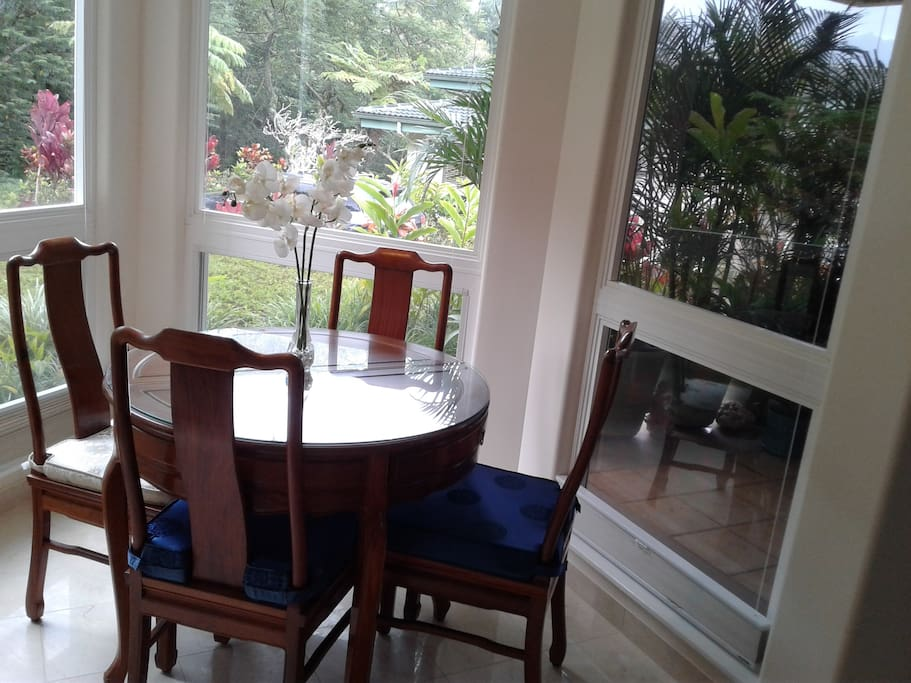 Dining area with view on tropical ravine