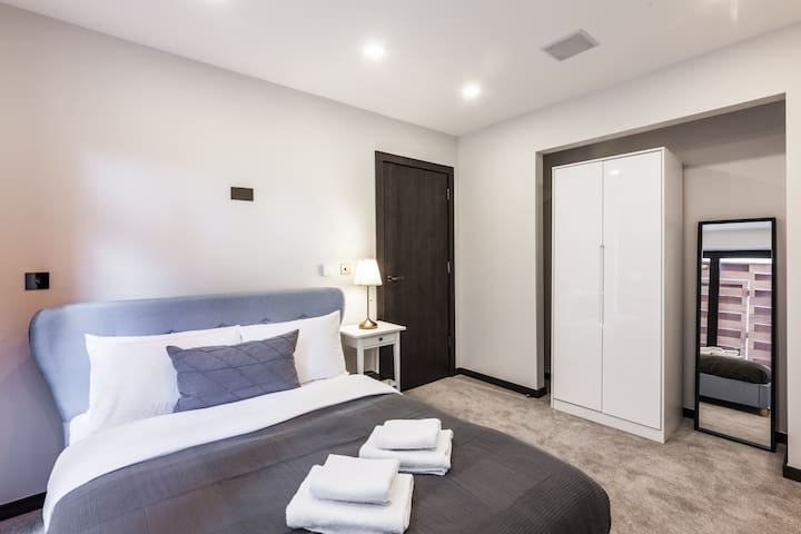 spacious double bedroom with standing modern cupboard