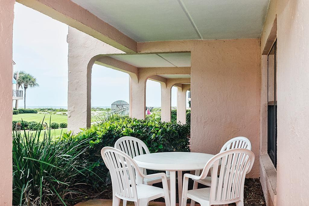 Kick back, relax, and admire the ocean views! - Our ground floor patio is the perfect place to sip your morning coffee and plan h