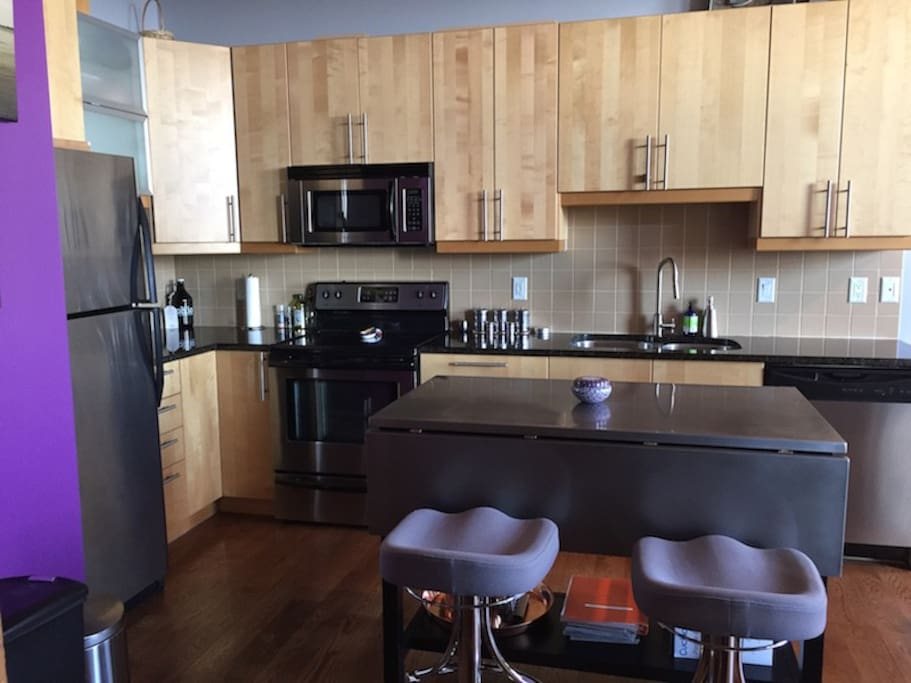 Large kitchen. Island bar extends for meals.