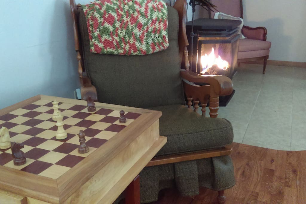 Snuggle up with grannys afghan while playing  on our  hand made custom chess board