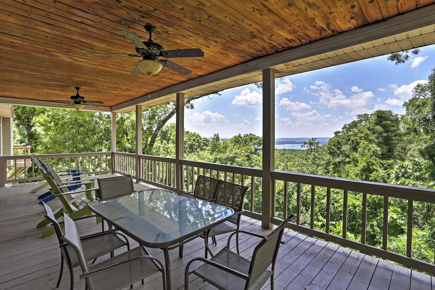 Look forward to mountain and lake views from this elevated deck when you stay at this 4-bedroom, 3.5-bath vacation rental home in Branson!