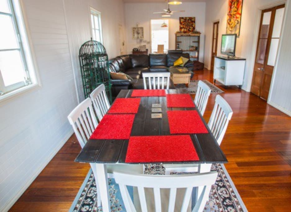 Upstairs open plan tropical living - wooden floorboards and traditional Queenslander features throughout