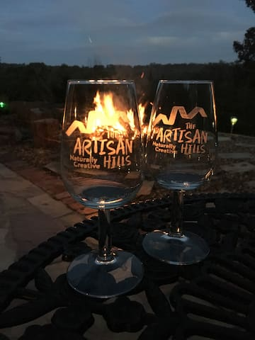 Enjoy a glass of wine around the fire