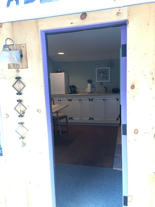 "Behind the purple door awaits an inviting space, where you can kick off your shoes and start your ""get-away""  time."