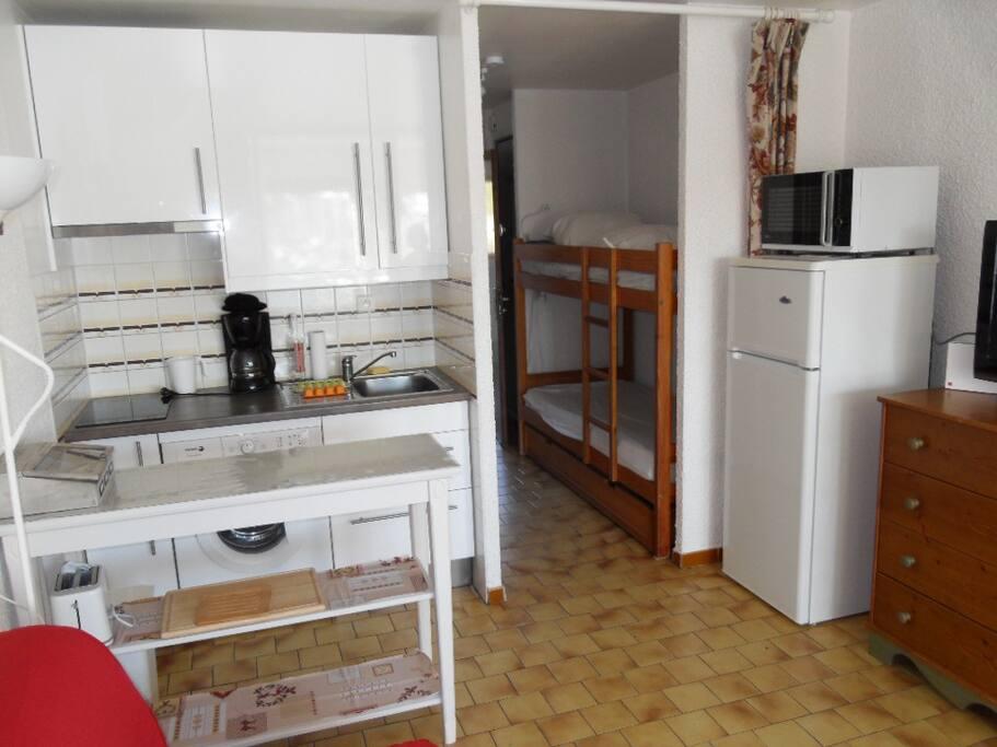 cuisine et couchage en cabine