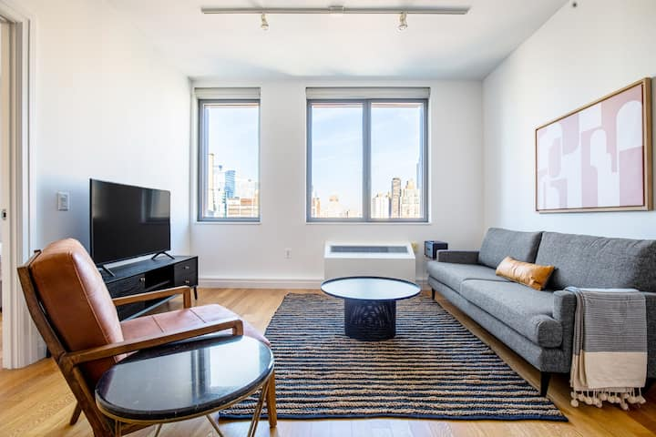 Sleek Midtown West 1BR w/ W/D, Gym, Pool, by Blueground