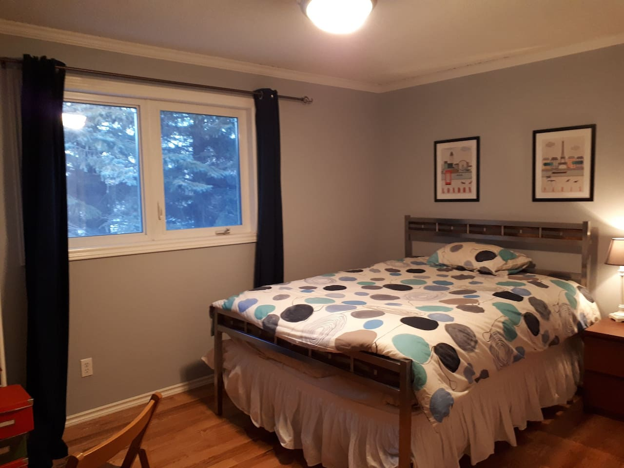 extra large bedroom with storage, work area and queen sized bed