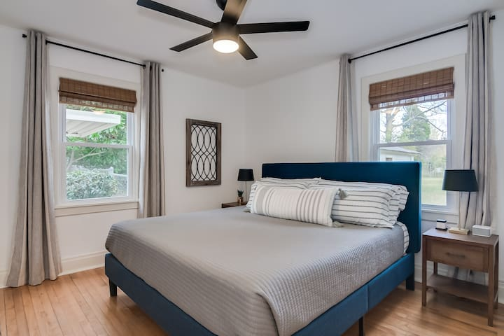 Bedroom with king bed and blackout curtains