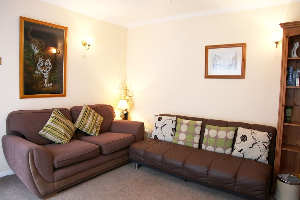 Lounge, with 2 sofas, 1 is a sofa bed, suitable for child.