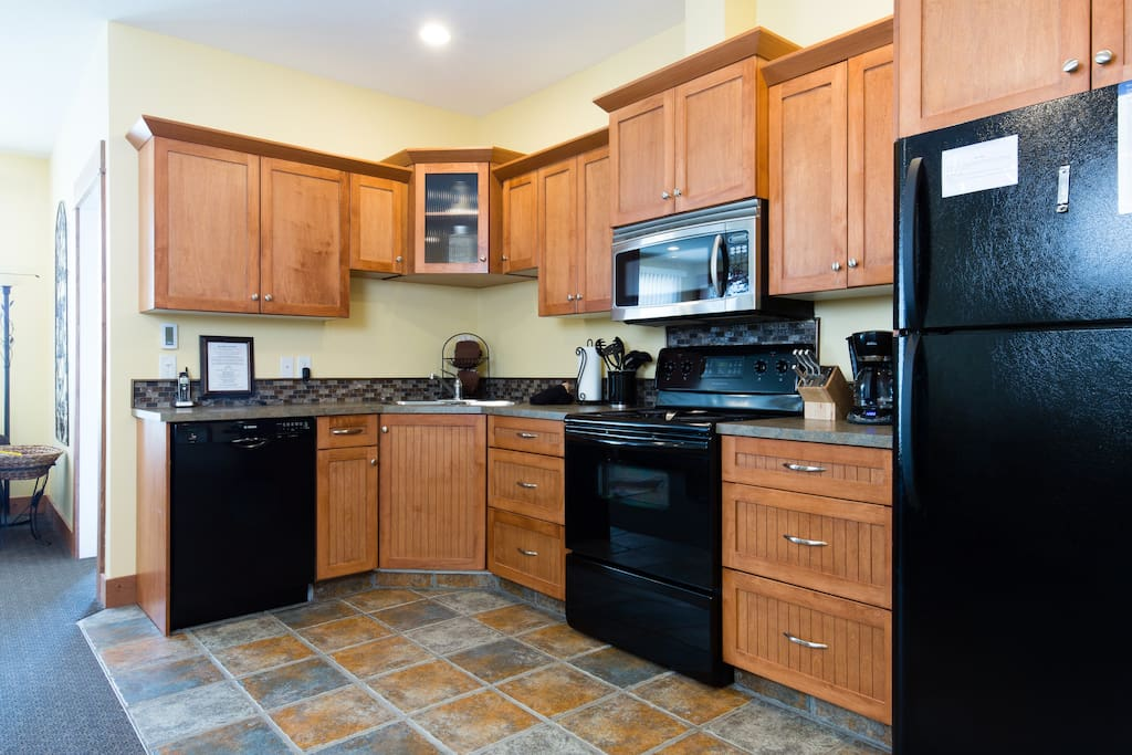 The kitchen has heated tile floors and fully stocked.