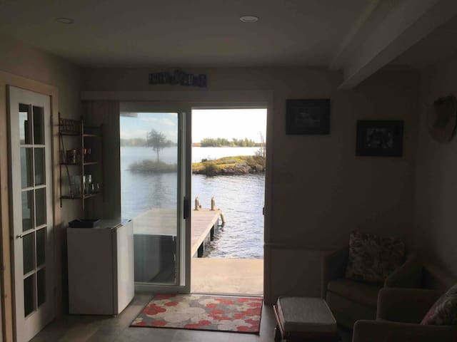 This is the view from your downstairs bedroom looking out the patio door to the lake.