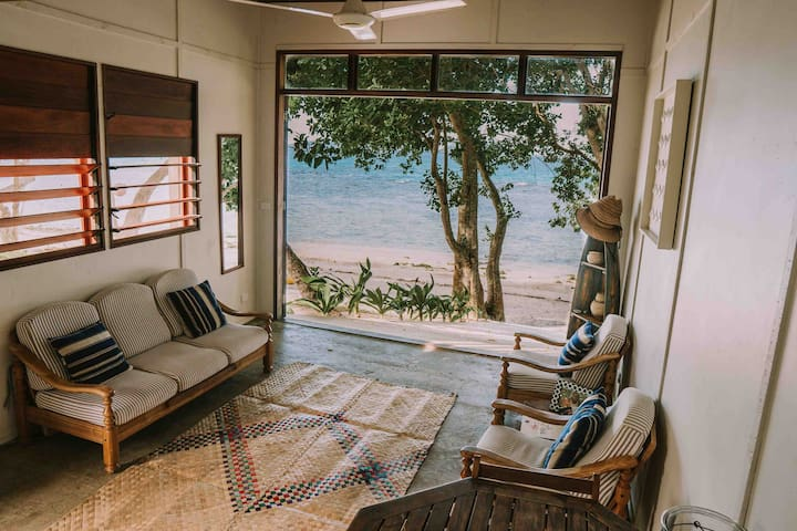 Whispering Palms Boat House - Absolute Beachfront