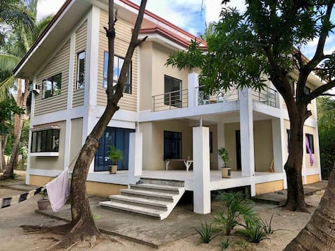 Room for rent in a beach front house and pool