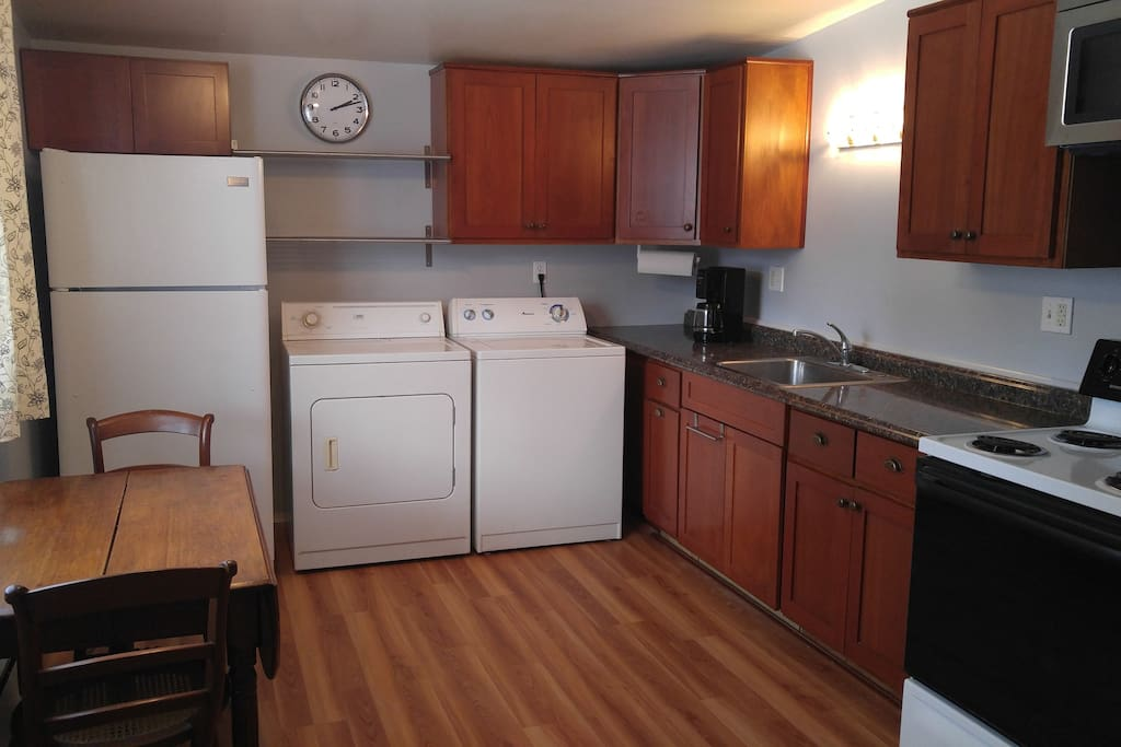 Full modern eat-in kitchen with microwave and washer/dryer.