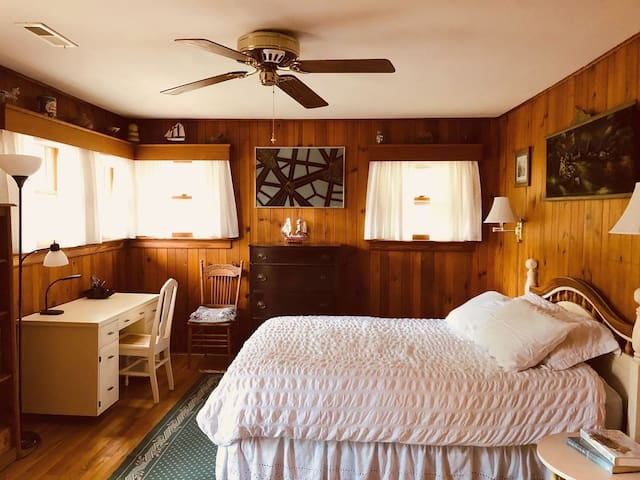 Large bedroom has a queen-sized bed has a queen-sized bed, plus a closet and dresser for your use.