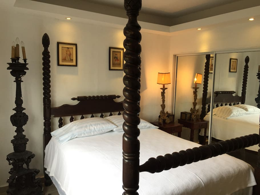 Very comfortable Authentic Hand carved bed by Local artisans, comfortable matress. Antique Lamps from Venice and Rome