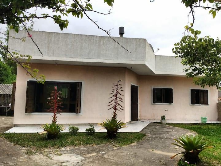 Sua casa na entrada de Tramandaí.