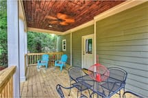 Back Porch. Great for relaxing, enjoying a coffee in the mornings or a drink and meal in the evenings.