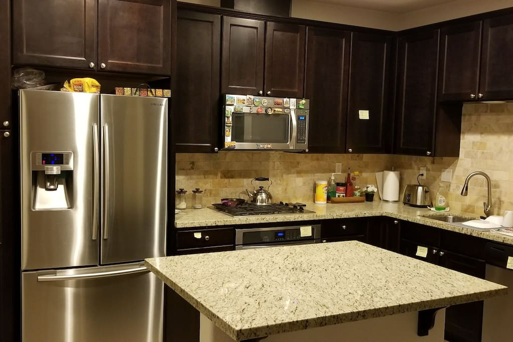 Kitchen with modern appliances and granite countertop marble from Brazil.