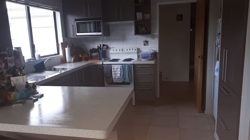 Modern, well equipped kitchen including new dishwasher. Breakfast bar and two stools.