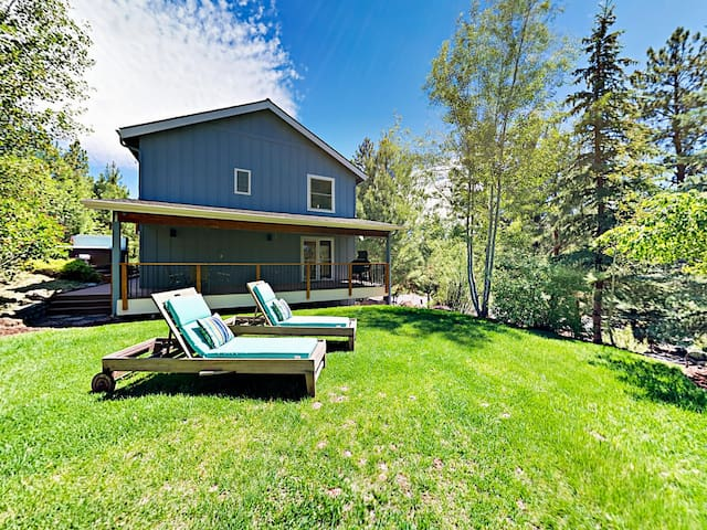 This tranquil oasis is situated on a half acre of land.