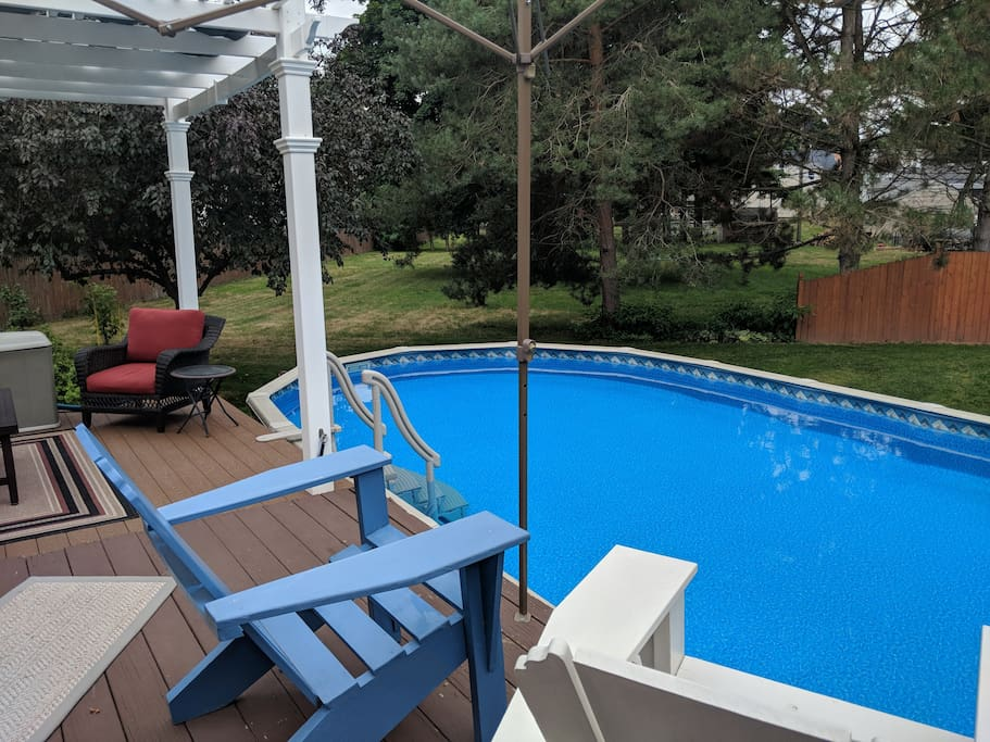 Oval pool with loads of deck space and seating