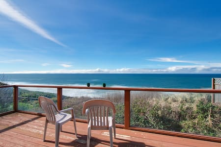 Dog-friendly A-frame cottage—oceanfront w/ ocean views & two blocks from beach!